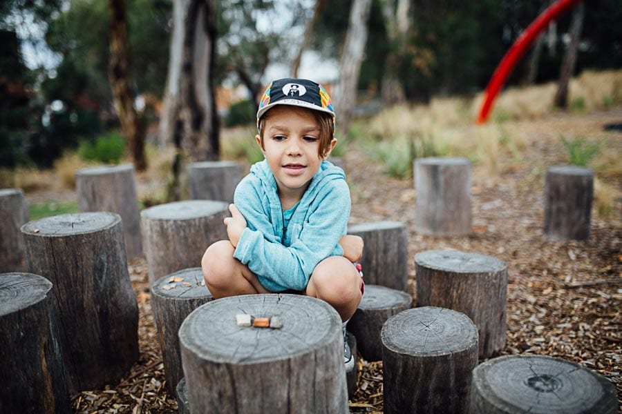 family photography melbourne family park boy imagination game