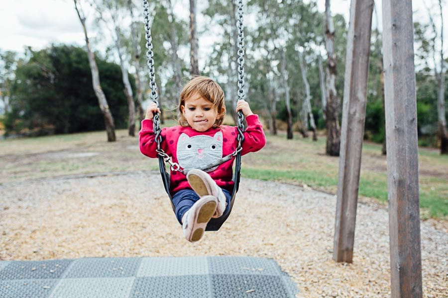 family photography melbourne baby girl park swing