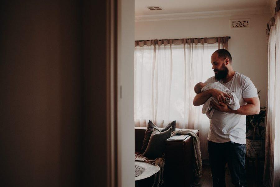 newborn baby girl in daddy's arms. Newborn photography Melbourne newborn baby photos melbourne baby photographer in home newborn photography session